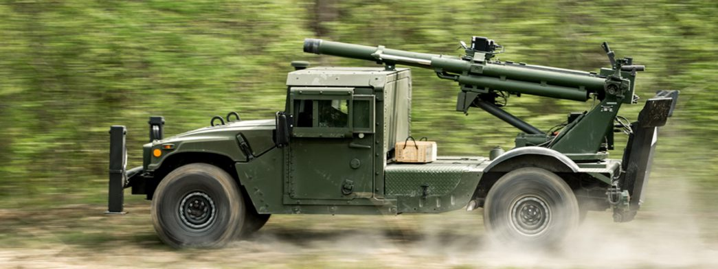 AM General's Humvee Hawkeye, Mobile Howitzer speeds by on an off-road trail