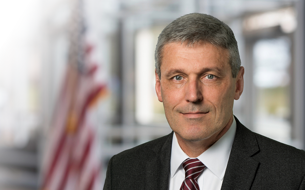 Portrait of AM General's Senior VP of DC Operations, John P. Chadbourne