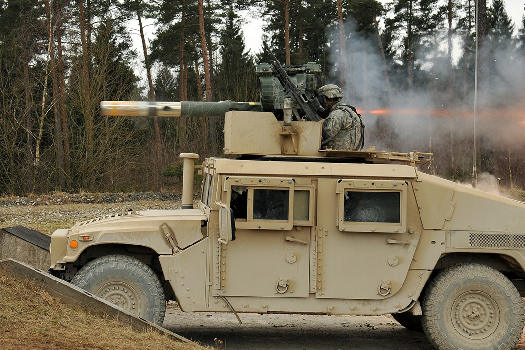 U.S. Marine firing a TOW Missile from M1167 Humvee