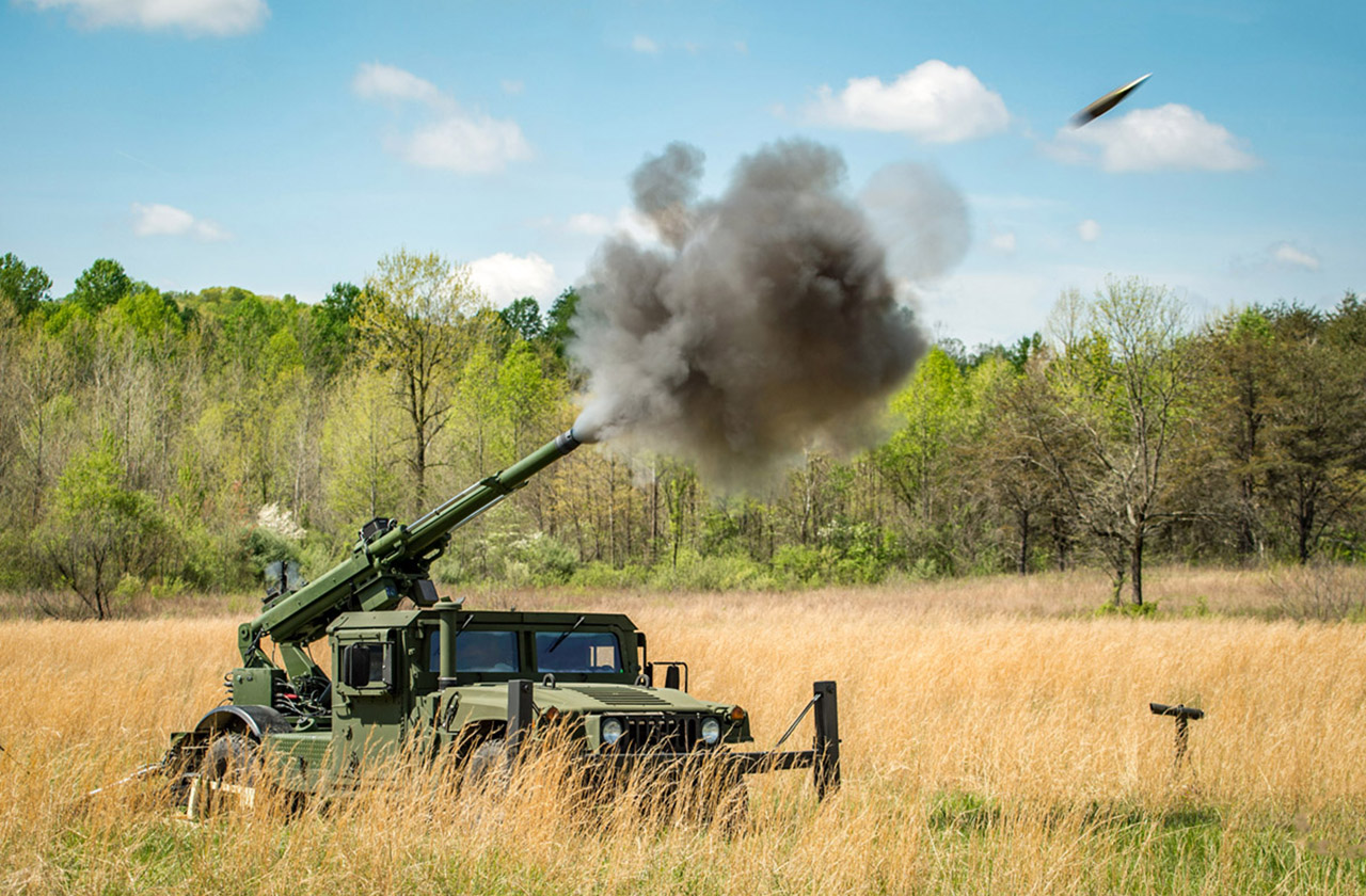 105mm shell in mi-air as it is fired from AM General's Mobile Howitzer Hawkeye