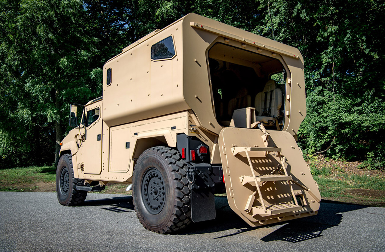 Rear 3/4 view of AM General's Multi Purpose Truck (MPT) with the back door open for troop loading